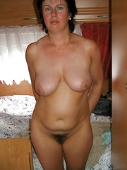 Brunette mature lady posing..