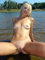 Gorgeous blonde housewife absolutely naked on the lake