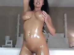 amateur oiled big titty brunette teasing