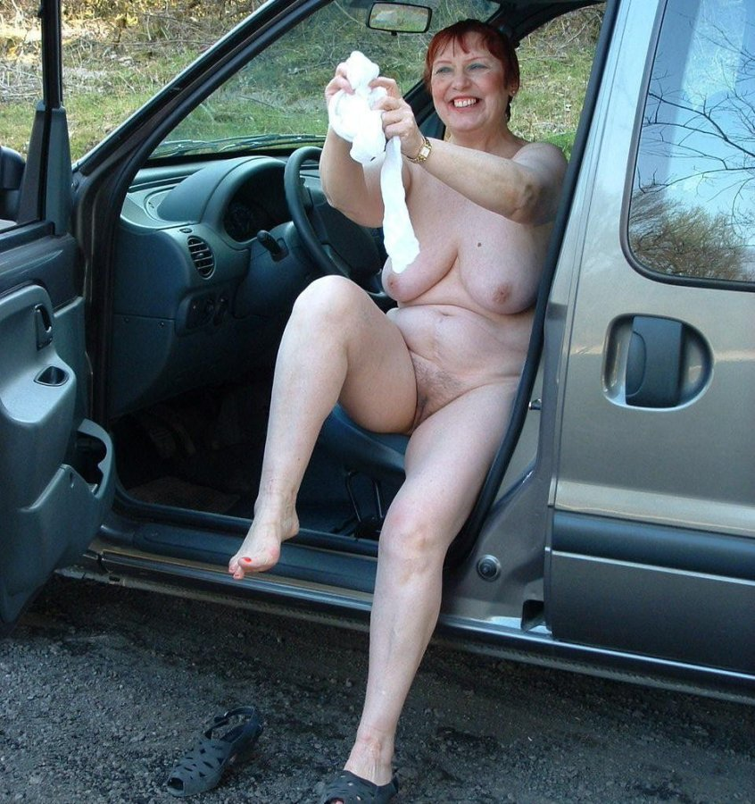 Naughty lady flashes in car 5